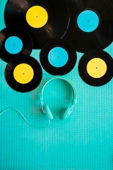 Headphones below some vinyls