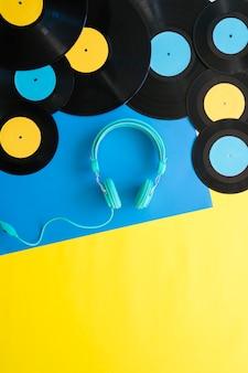 Headphones below various vinyls