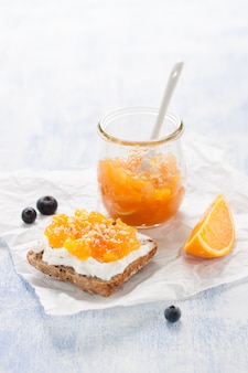 Healthy breakfast with whole bread and orange jam