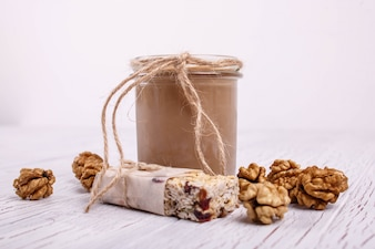 Healthy brown smoothie with walnuts lie on the table