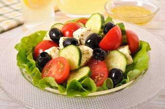 Healthy greek salad in glass bowl