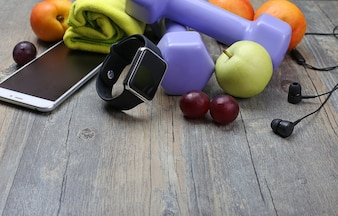 Healthy lifestyle dumbbell smart watch and fruit