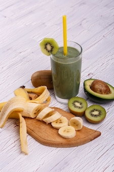Healthy smoothie with bananas,avocado,lime and ginger lie on the table