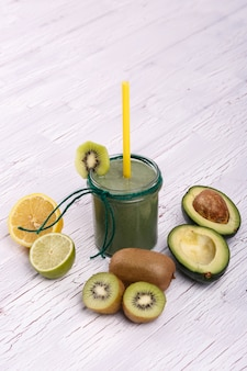 Healthy smoothie with lime,avocado and kiwi lie on the table