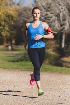 Healthy young woman running in the park