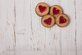 Heart-shaped cookies on a wooden table