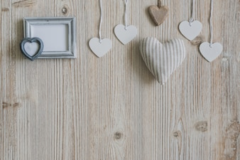 Hearts hanging from ropes and a gray photo frame