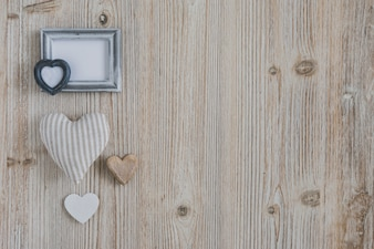 Hearts of different sizes and a gray frame
