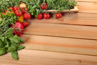 Herbs and vegetables with a wooden board