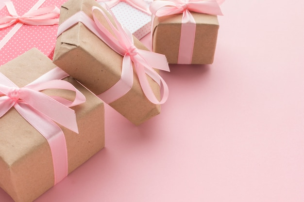 High angle of pink gifts with copy space