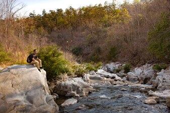 Hiker sitting on big rock