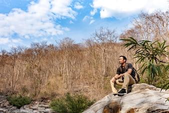 Hiker taking a rest on a rock