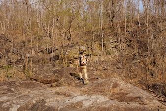 Hiker walking into woods