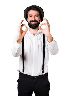 Hipster man with beard making OK sign