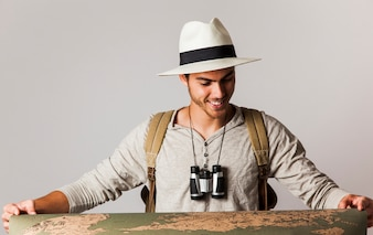 Hipster style tourist with big map