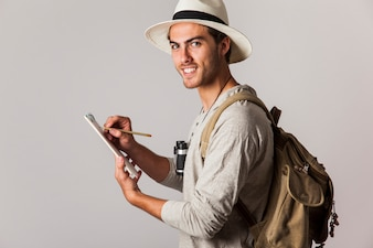 Hipster style tourist with clipboard