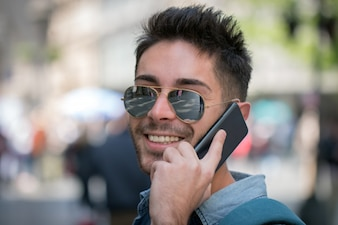 Hipster talking on cell phone