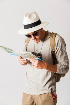 Hipster tourist looking at city map