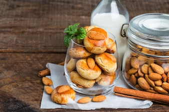 Homemade Almond cookies on a shabby wooden table background.