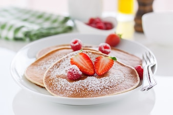 Homemade buttermilk pancakes with fresh strawberry