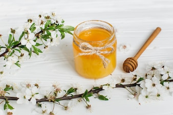 Honey on wooden background