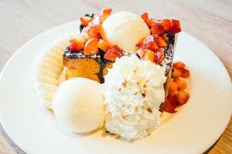 Honey toast with ice cream and strawberry and banana