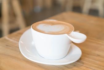 Hot latte coffee in shop