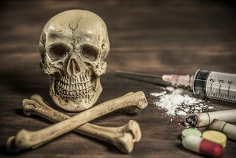 Human skull and crossbones drug addict concept