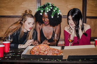 Hungry friends with pizza