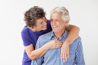Husband cuddling positive adult care