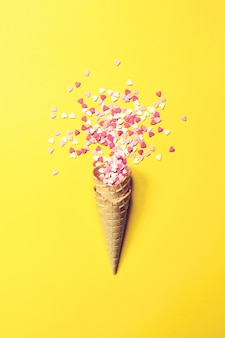 Ice cream cone with small caramel hearts