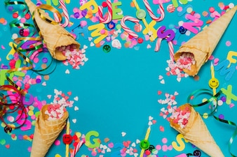 Ice cream cones with hearts and confetti on a blue background