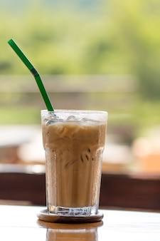 Iced chocolate on outdoor wood desk background
