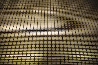 Illuminated wall with metallic pattern background