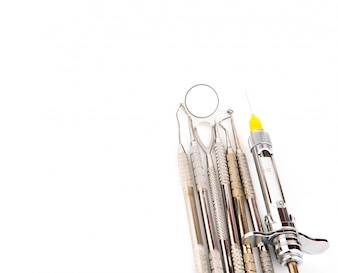 Instruments of a dentist with white background