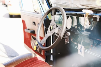 Interior of old car with open door