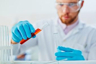 Investigation human chemist man flask