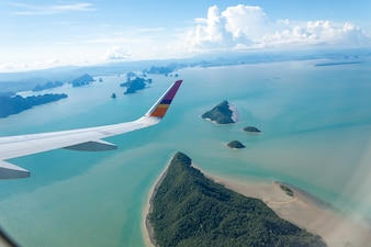 Island and sea with plane wing