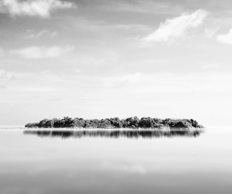 Island seen from afar in black and white