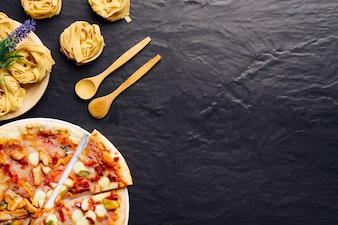 Italian food composition with pizza and space on right