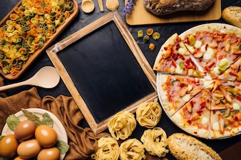 Italian food composition with slate and pizza