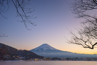 Japan, Fuji mountain, Kawaguchiko lake in autumn afternoon, With warm sunlight effect created reflection highlight shadow at the mountain, land, lake and building