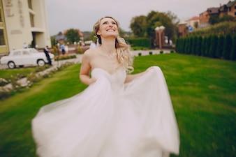 Joyful bride looking at the sky