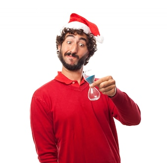 Joyful guy looking at his hourglass