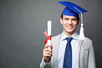 Joyful guy with his diploma