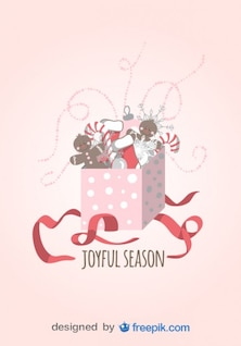 Joyful season Greeting Card of Gift opened with Candy Canes, Christmas Socks and dolls