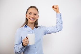 Joyful Woman Celebrating Success and Drinking Tea