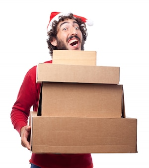 Joyful young man holding boxes