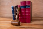 Judges gavel with books