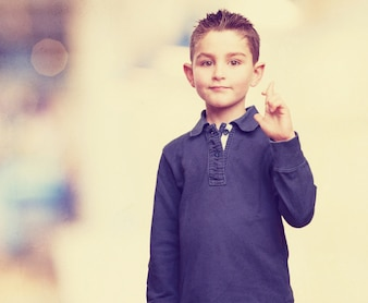 Kid with cross fingers